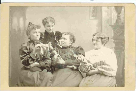 four ladies holding their bananas