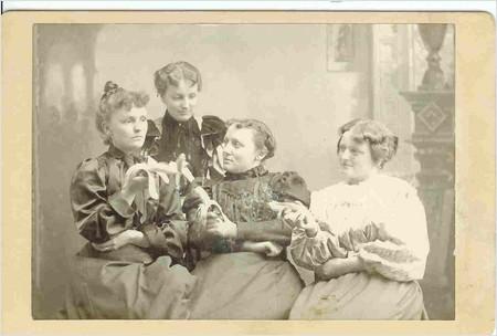 four ladies holding their bananas