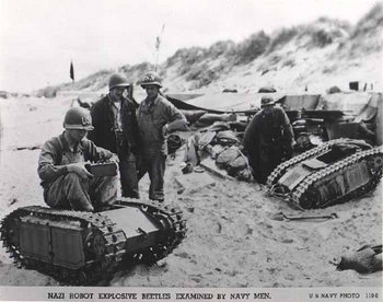 NAZI ROBOT EXPLOSIVE BEETLES EXAMINED BY NAVY MEN