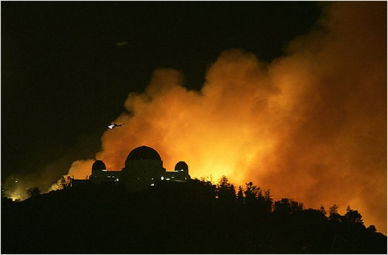 LA Times photo of the griffith park observatory with fire behind it